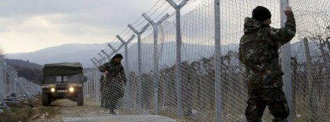 """FILE - In this February 8, 2016 file photo, Macedonian Army soldiers erect a second fence on the border line with Greece, near the southern Macedonia's town of Gevgelija. Six nations from Central and Eastern Europe meet Monday in Prague to discuss plans for a new """"line of defense"""" for Europe that involves a double fence along Greece's northern border. (AP Photo/Boris Grdanoski, File)"""