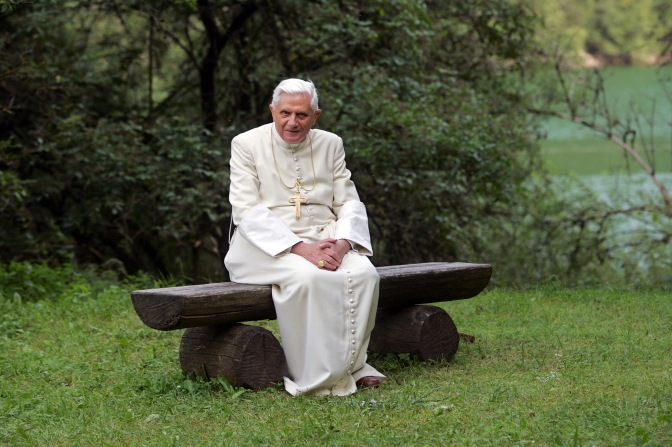 Pope Benedict XVI poses for photos on a bench outside the Madonna della Salute chapel in Lorenzago di Cadore, a small town in northern Italy's mountain region July 23. Throughout the year the pope and Vatican officials gave increased attention to environmental concerns. (CNS photo/Alessia Giuliani, Catholic Press Photo) (Dec. 13, 2007) See VATICAN LETTER to come.