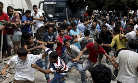 "ATTENTION EDITORS - REUTERS PICTURE HIGHLIGHTPakistani, Iranian and Afghani migrants scuffle outside the police station of the city of Kos over priority at a registration queue on the Greek island of Kos, August 15, 2015. The United Nations refugee agency (UNHCR) called on Greece to take control of the ""total chaos"" on Mediterranean islands, where thousands of migrants have landed. About 124,000 have arrived this year by sea, many via Turkey, according to Vincent Cochetel, UNHCR director for Europe. REUTERS/Alkis Konstantinidis TPX IMAGES OF THE DAYREUTERS NEWS PICTURES HAS NOW MADE IT EASIER TO FIND THE BEST PHOTOS FROM THE MOST IMPORTANT STORIES AND TOP STANDALONES EACH DAY. Search for ""TPX"" in the IPTC Supplemental Category field or ""IMAGES OF THE DAY"" in the Caption field and you will find a selection of 80-100 of our daily Top Pictures.REUTERS NEWS PICTURES. TEMPLATE OUT"